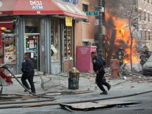 Emergency crews respond to an explosion that leveled two apartment buildings in the East Harlem neighborhood of New York, Wednesday, March 12, 2014. The blast happened after a neighbor reported smelling natural gas. (AP Photo/Jeremy Sailing)