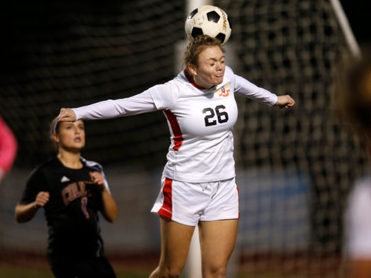 Leon's Presley Reeves heads against Columbia during their district semifinal game at Chiles High School on Wednesday.