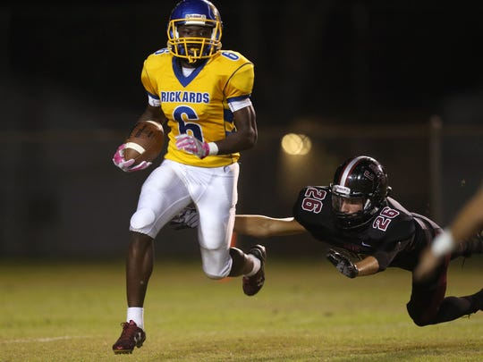 Rickards' Ferante Cowart outruns a diving Dillon Haire of Chiles during their game at Cox Stadium on Friday.