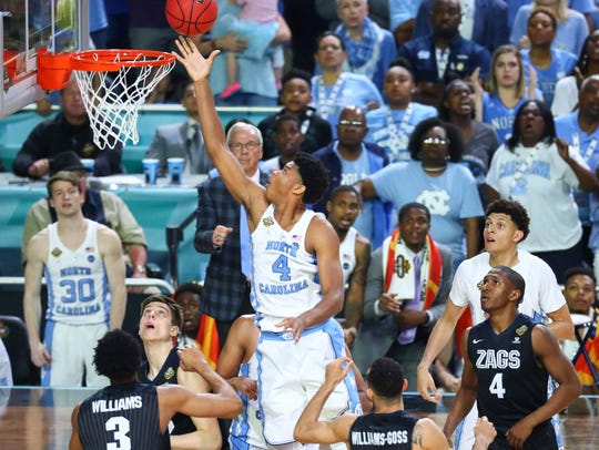 North Carolina forward Isaiah Hicks scores two points