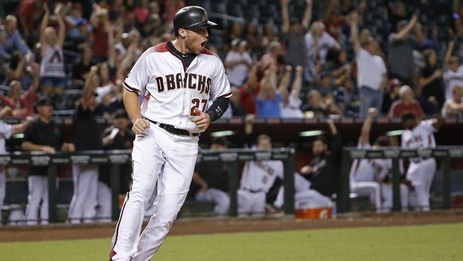 Diamondbacks' Brandon Drury (27) yells as he comes home on a grand slam from teammate Yasmany Tomas at Chase Field on September 12, 2016 in Phoenix, Ariz.