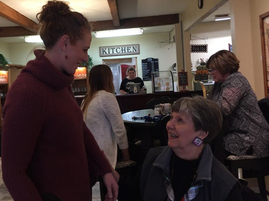 "Carmelle Bielenberg, acting director of the Stayton Sublimity Chamber of Commerce, and Linda Sunderland, one of the chamber's ""Home for the Holidays"" promotion winners, visit Canyon Conversations."