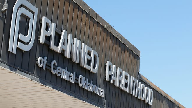 FILE - This July 24, 2015, file photo shows a sign at a Planned Parenthood Clinic in Oklahoma City.