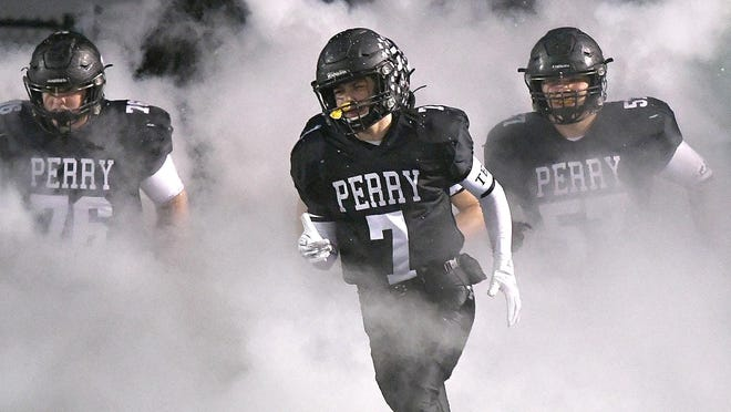 The Perry Panthers hit the field prior to last year's football game against McKinley.