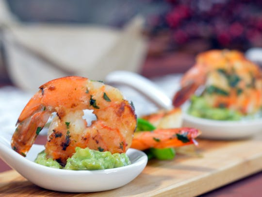 Tequila flambe shrimp can be served over guacamole