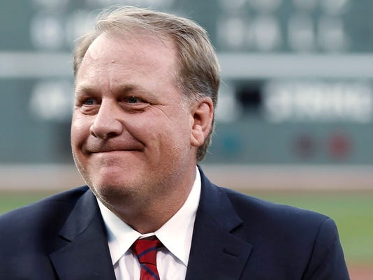 """FILE In this Aug. 3, 2012, file photo, former Boston Red Sox pitcher Curt Schilling reacts after being introduced as a new member of the Boston Red Sox Hall of Fame, at Fenway Park in Boston. ESPN says commentator Schilling won't appear on the air for the next month in the wake of his anti-Muslim tweet. ESPN said Thursday, Sept. 3, 2015, that Schilling won't be on telecasts for the rest of the regular season or the American League wild-card game on Oct. 6. The former star pitcher and """"Sunday Night Baseball"""" analyst was pulled by ESPN from a major league game and the network's coverage of the Little League World Series last month after he retweeted a post that compared Muslim extremists and Nazis. (AP Photo/Winslow Townson, File)"""