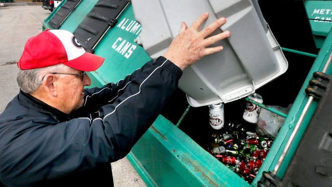 Robert Lutte recycles aluminum cans after first collecting the recyclables in separate bins before dumping the items directly into the recycling bins at the Rutherford County Recycling Center on Tuesday, Feb. 13, 2018.