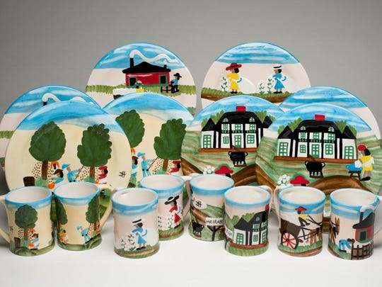 Clementine Hunter-inspired dinnerware includes plates and mugs in a good sampling of her most popular designs.