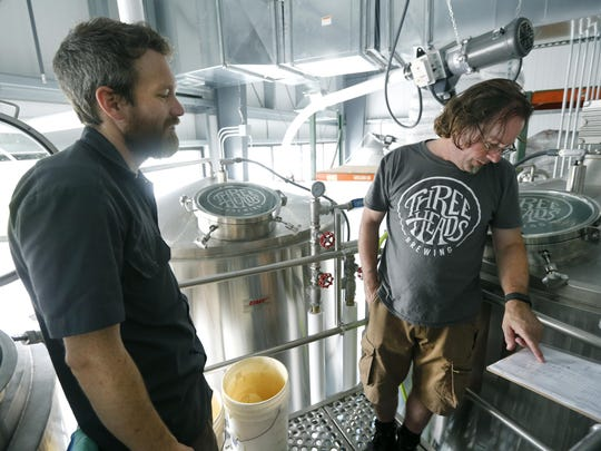 Lead brewer Casey Kindlon and brewmaster Brush Lish make sure things are on track at the new Three Heads Brewery on Atlantic Avenue.