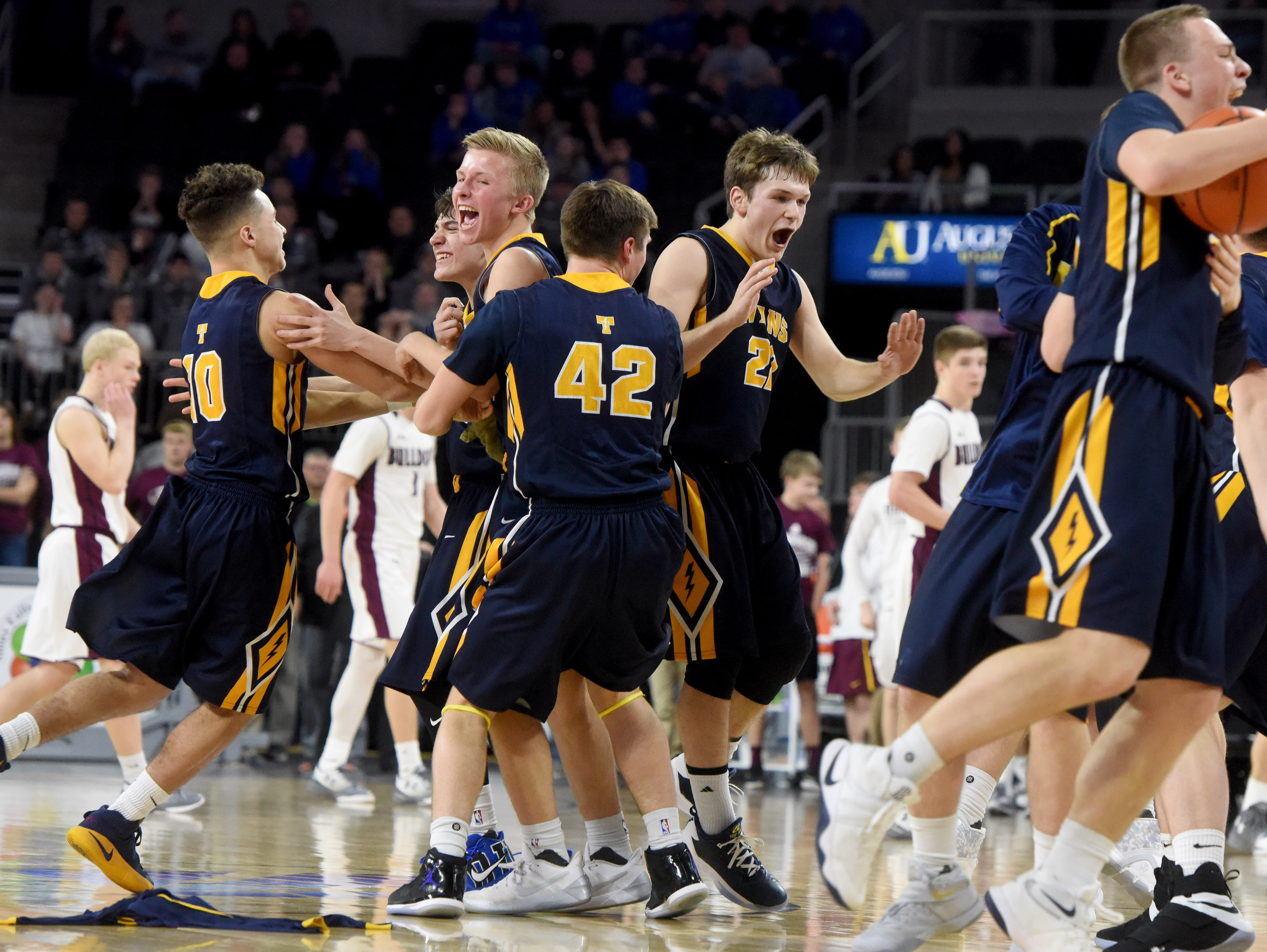Tea Area celebrate their victory over Madison during the 2017 SDHSAA Class A boy's basketball championship at the Denny Sanford Premier Center on Saturday, March 18, 2017.