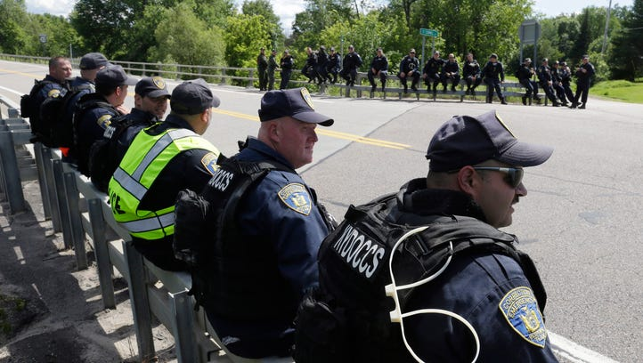 New York State officers take a break from searching