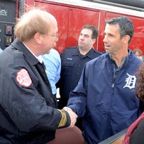 Detroit Tigers manager Brad Ausmus shakes hands with Northville Fire Chief Steve Ott on Jan. 23 as the Tiger's Winter Caravan makes a pit-stop at Northville City Hall.