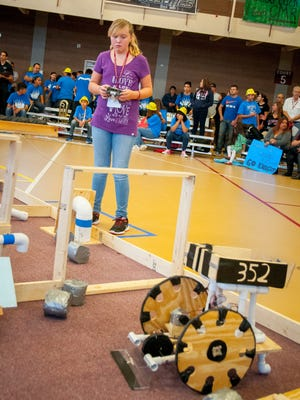 McKynze Hamrick, 11, pilots a robot for Camino Real Middle School in the NM BEST Robotics Competition at NMSU's James B. Delamater Activity Center on Saturday.