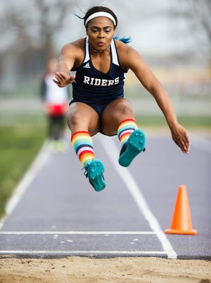 Roosevelt senior Briyana Carter competes in the long jump during the Waukee Girls' Invitational on Tuesday.