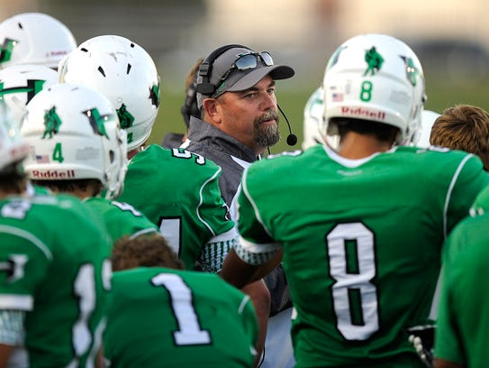 Hamlin head coach Russell Lucas talks with his players