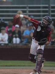 Chiles catcher Garrett Greene throws the ball around after a strikeout.