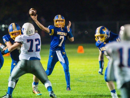 Milton's Jacob Laware passes against Mt. Anthony in