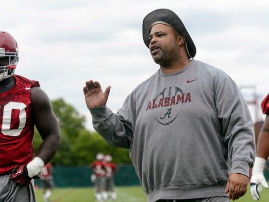 FILE - In this April 17, 2014, file photo, Alabama defensive line coach Bo Davis works with his linemen during NCAA college spring football practice, in Tuscaloosa, Ala. The NCAA has imposed a two-year show cause penalty against former Alabama assistant coach Bo Davis for recruiting violations. NCAA findings released Friday, April 14, 2017, said Davis knowingly violated rules in a meeting with four prospects that was arranged by a booster. Alabama fired Davis in April 2016. Davis is currently the defensive line coach for Texas-San Antonio.(Vasha Hunt/AL.com via AP, File)