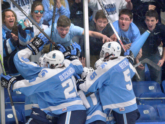 "Members of Stevenson's ""Blue Crew"" celebrate a goal"
