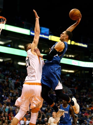 Minnesota Timberwolves guard Zach LaVine (right) goes up for a dunk over Phoenix Suns center Alex Len.