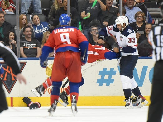 Team USA defenseman Dustin Byfuglien (33) punches Team