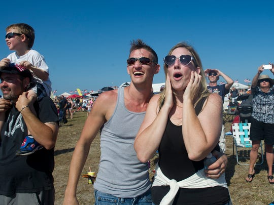 Spectators react to the screaming sounds of the F-16 at last year's Stuart Air Show at Witham Field in Stuart.