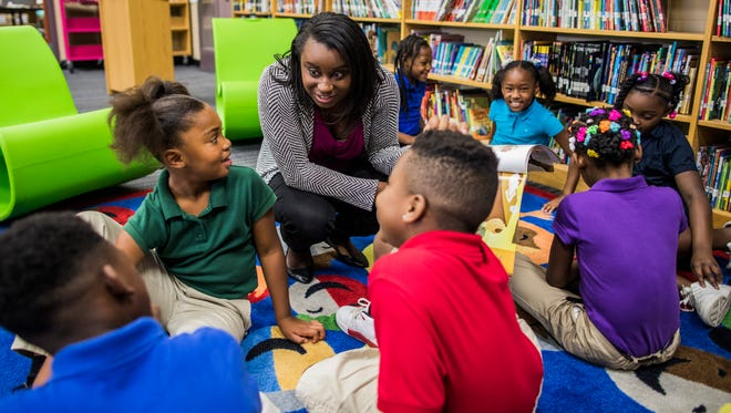 Literacy Teacher Development Specialist Irene Holden reads to second graders at Buena Vista Elementary School. Buena Vista will become one of six schools to get a pilot program that will bring more resources for teaching literacy at the school.