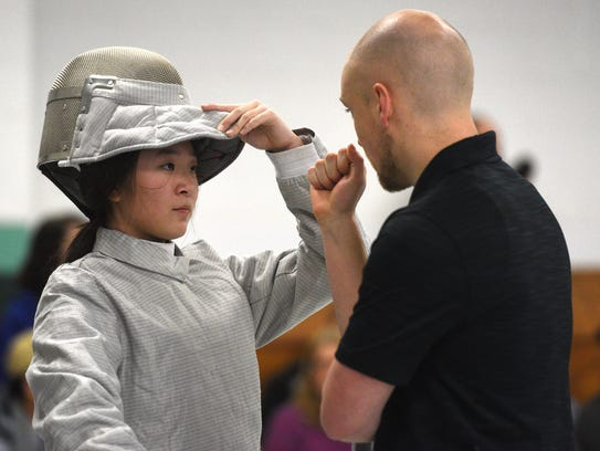 Lauren Lee, Kinnelon's lone female sabre, gets some