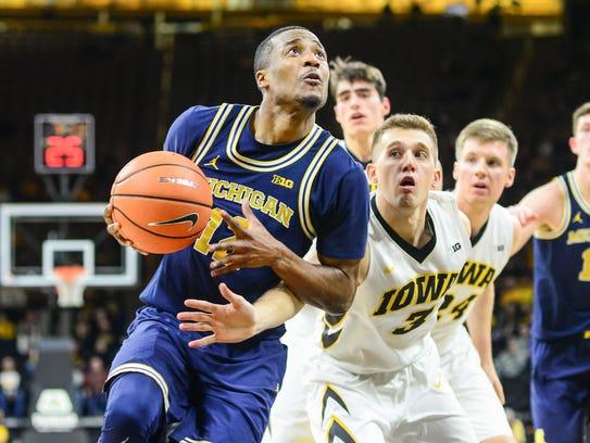 Michigan guard Muhammad-Ali Abdur-Rahkman (12) goes