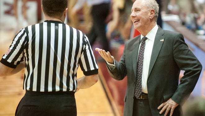 Bellarmine Knights head basketball coach Scott  Davenport works the official during the game.18 January 2016