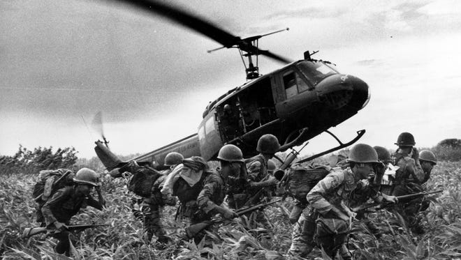 South Vietnamese Marines rush to the point where a descending U.S. Army helicopter will pick them up after a sweep east of the Cambodian town of Prey-Veng in June 1970 during the Vietnam War.