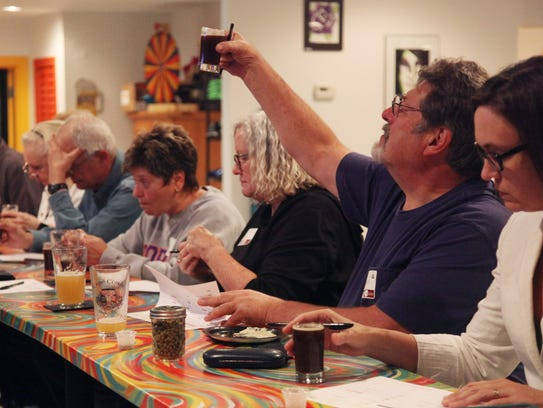 Dan Miller prepares to taste test some local brew at