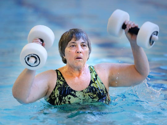 Carolyn Beets takes part in the Aquacise class Thursday, July 6, 2017, at the YWCA. Beets, who had both knees replaced 11 months ago, said working out in the pool is much easier on her joints.