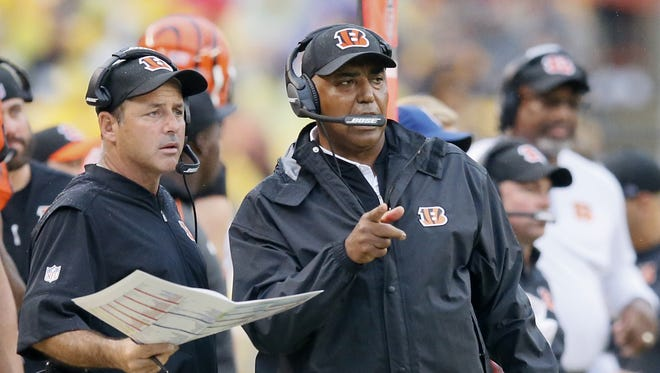 Cincinnati Bengals head coach Marvin Lewis, right, would not discuss the future of offensive coordinator Ken Zampese after two weeks into the 2017 season.