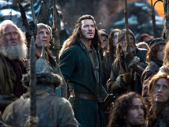 Luke Evans (center) prepares for action in The Hobbit The Battle of the Five Armies.