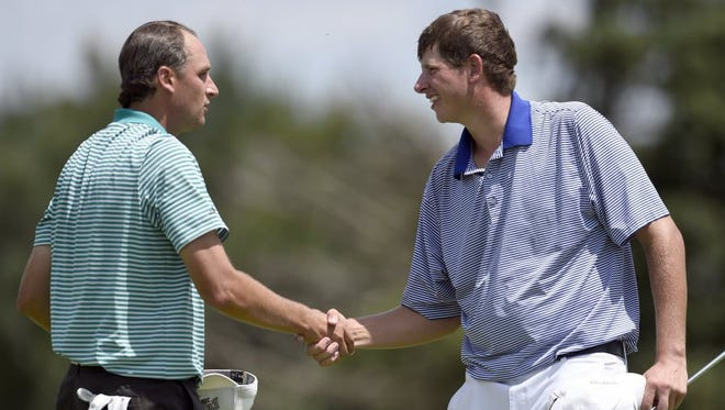 Chip Tiemann (left) shakes hands with Matthew Ladd after completing the second round of the Evansville Courier & Press Men's City Tournament at Fendrich Golf Course in Evansville Sunday. Ladd fired a 3-under 67 to move to 5 under midway through the tournament.