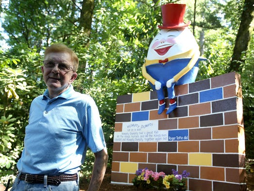 Roger Tofte sits next to Humpty Dumpty at Enchanted Forest on Tuesday, Aug. 26, 2014, in Turner, Ore.