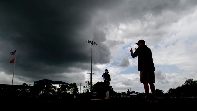 Storm clouds hover over a Division II-A softball game between King's Academy and Friendship Christian at Starplex in Murfreesboro on Wednesday, May 24, 2017.