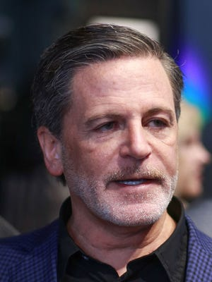 Quicken Loans Inc. founder and chairman Dan Gilbert speaks to press during the opening of the John Varvatos store in downtown Detroit on Thursday March 12, 2015.