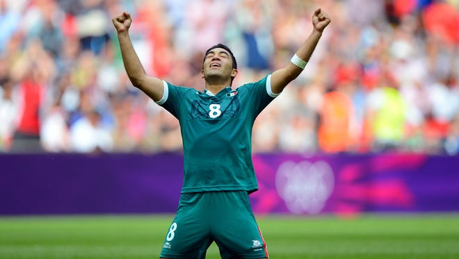 Mexico forward Marco Fabian (8) celebrates after defeating Brazil 2-1 during the men's soccer gold medal match in the 2012 London Olympic Games at Wembley Stadium on Aug. 11.