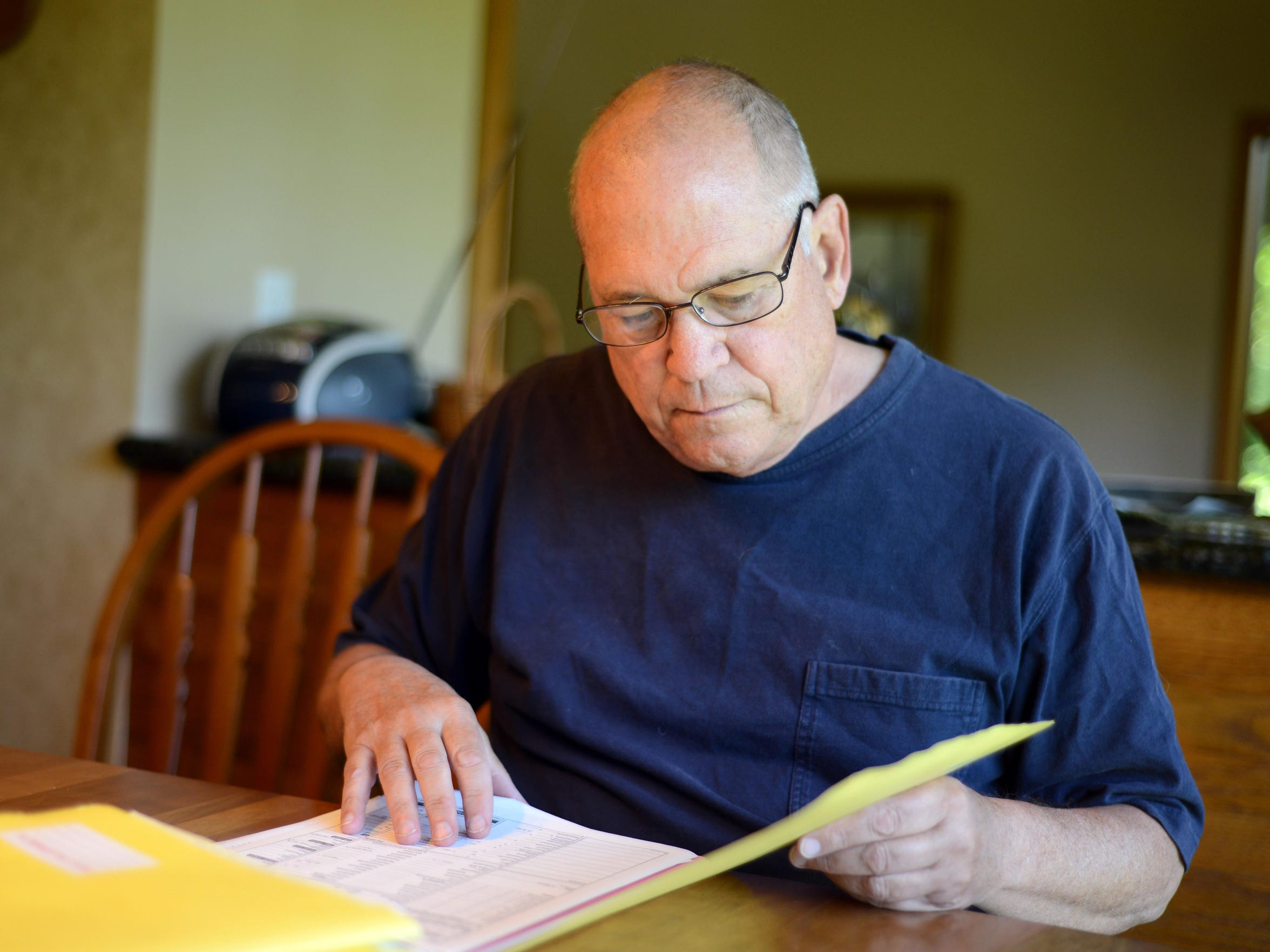 Dr. Peter Rasmussen reviews the charts of patients he has helped through Oregon's Death With Dignity Act. All the years that he has assisted his patients through end of life are now circling back to help him face his own death.