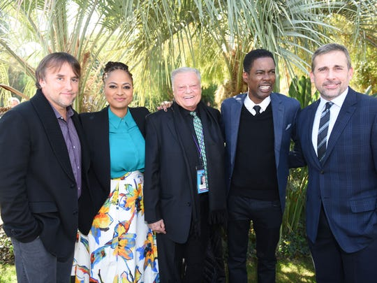 "Richard Linklater, director of ""Boyhood""; Ava Duvernay, director of ""Selma""; Harold Matzner, Palm Springs International Film Festival chairman; honoree Chris Rock; and honoree Steve Carell share some time together at the Variety Creative Impact Awards brunch at the Parker Palm Springs."