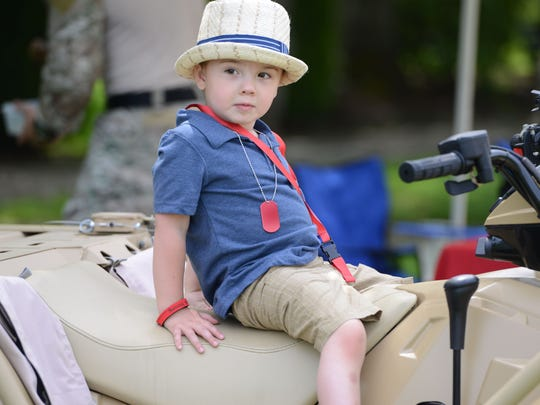 Jack Buczynski, 3, sits on an up-armored quad at the Armed Forces Day ceremony at the Oregon State Capitol in Salem on Thursday, May 15, 2014.