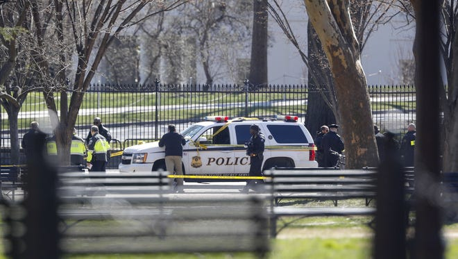 Law enforcement officers gather in front of the White House in Washington, Saturday, March 3, 2018.    The Secret Service says a man shot himself outside the White House, and medical personnel are on the scene.