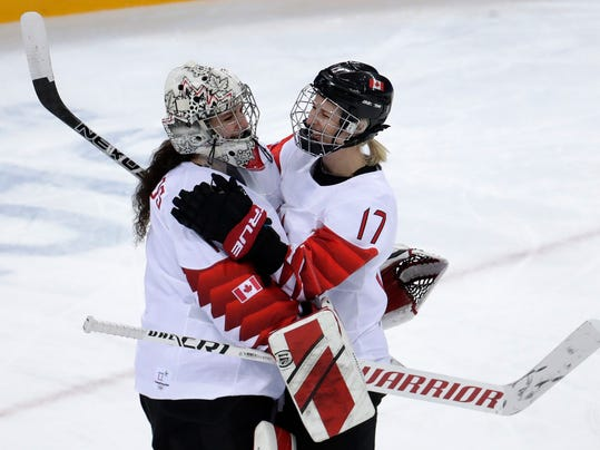 goalie Shannon Szabados (1), of Canada, and Bailey Bram (17), of Canada, celebrate after the semifinal round of the women's hockey game against the team from Russia at the 2018 Winter Olympics in Gangneung, South Korea, Monday, Feb. 19, 2018. Canada won 5-0. (AP Photo/Julio Cortez)