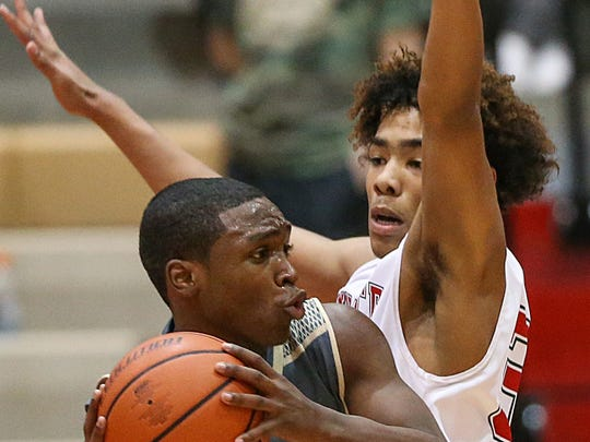 Lawrence North Wildcats' DJ Hughes (right)