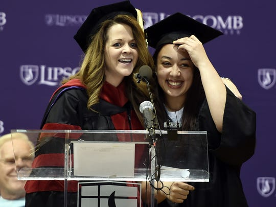 Inmate Cyntoia Brown (right) of the Tennessee Prison for Women gets a hug from a Lipscomb University faculty member after delivering a commencement address before she received her Associate Degrees from Lipscomb University Friday Dec. 18, 2015, in Nashville, Tenn.