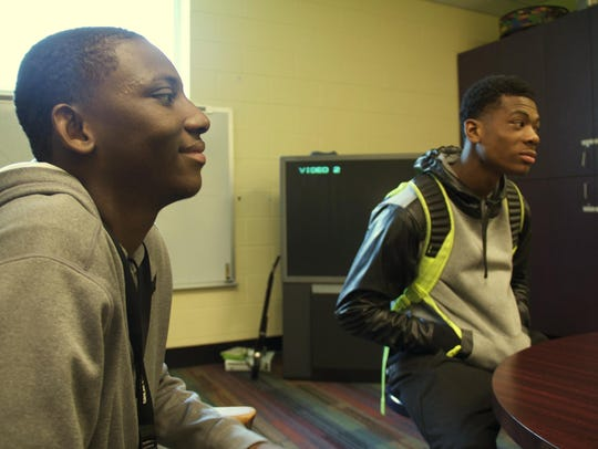 Illa Daff, 20, left, and Terrell James, 16, right,