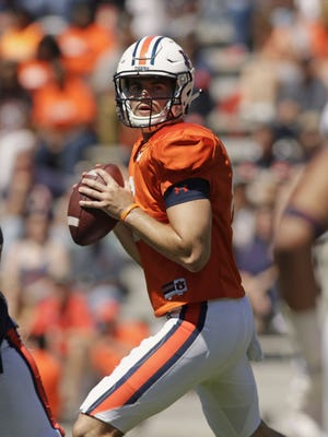 Auburn quarterback Jarrett Stidham looks for a receiver during Auburn's NCAA college football spring game in Auburn, Ala.