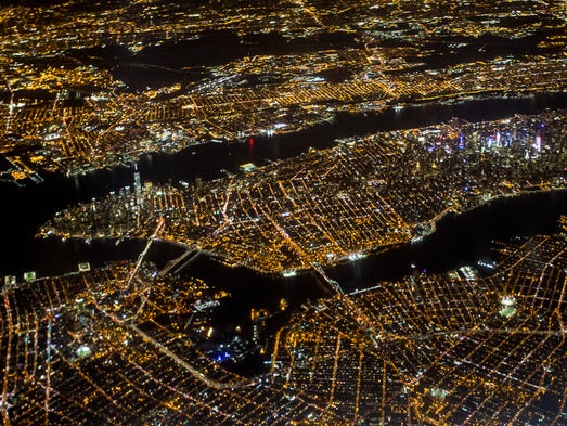 The island of Manhattan radiates light as a Delta flight